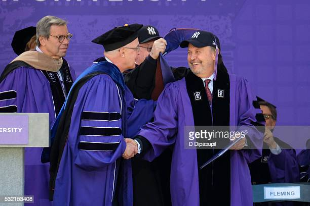 Billy Crystal shakes hands with NYU president Andrew Hamilton while receiving an honorary doctorate degree during the 2016 New York University...