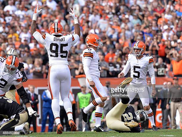 Billy Cundiff of the Cleveland Browns celebrates his game winning field goal with Spencer Lanning and Armonty Bryant of the Cleveland Browns in front...