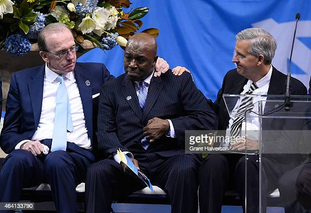 Billy Cunningham, left, comforts an emotional Phil Ford, center, during a memorial service for former North Carolina Tar Heels basketball coach Dean...