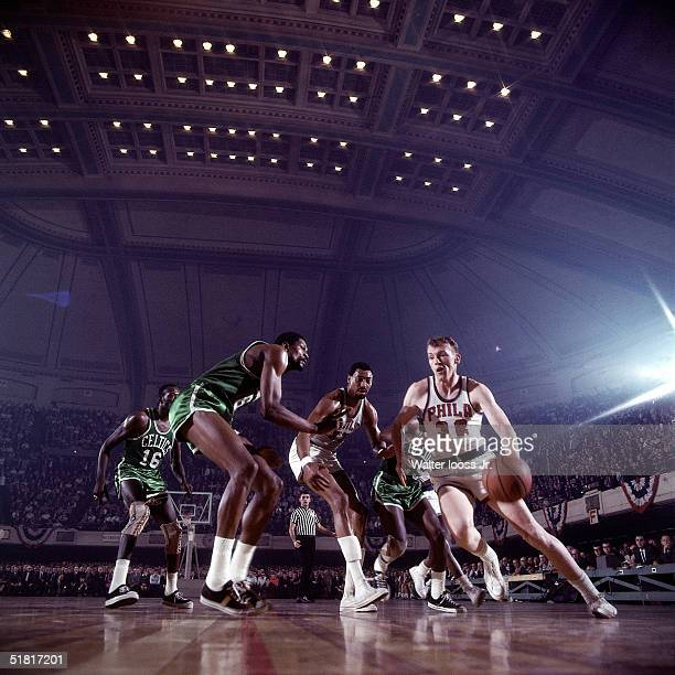Billy Cunningham of the Philadelphia 76ers drives to the basket against the Boston Celtics during an NBA game at the Spectrum circa 1970 in...