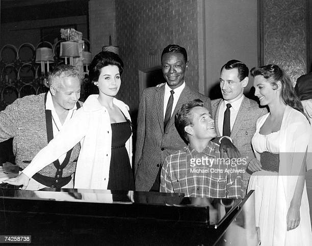 Billy Daniels Cathy Crosby Nat King Cole Dean Jones Ray Anthony and Julie London stars of the film Night Of The Quarter Moon gather for a a chicken...