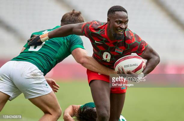 Billy Dardis of Ireland and Nelson Oyoo of Kenya battle for the ball during the Rugby Pool c match between Kenya and Ireland on day four of the Tokyo...