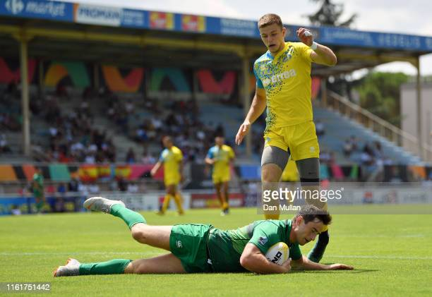 Billy Dardis of Ireland dives over for a try during the Group B match between Ireland and Ukraine on day one of the Mens 7s Olympic Games Regional...