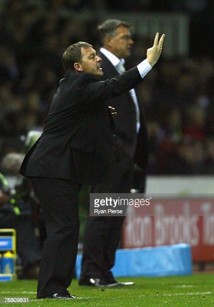 Billy Davies manager of Derby County reacts as Sam Allardyce manager of Newcastle United looks on during the Barclays Premier League match between...