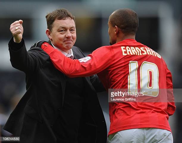Billy Davies of Nottingham Forest celebrates victory with Robert Earnshaw after the npower Championship match between Derby County and Nottingham...