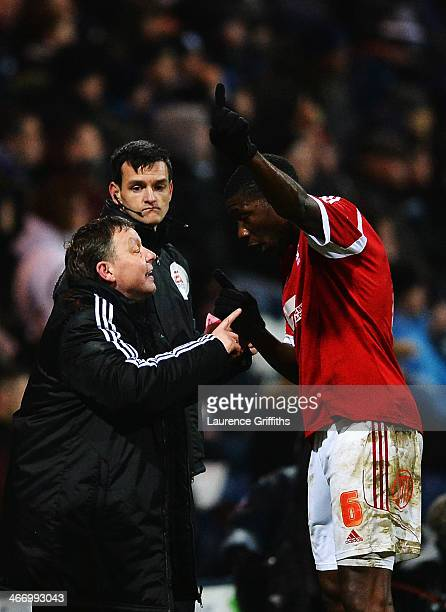 Billy Davies the Nottingham Forest manager gives instructions to Guy Moussi during the FA Cup Fourth Round Replay match between Preston North End and...