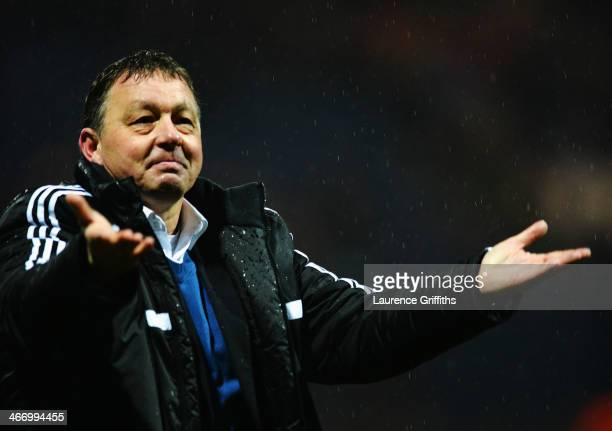 Billy Davies the Nottingham Forest manager reacts at fulltime as his side wins the FA Cup Fourth Round Replay match between Preston North End and...
