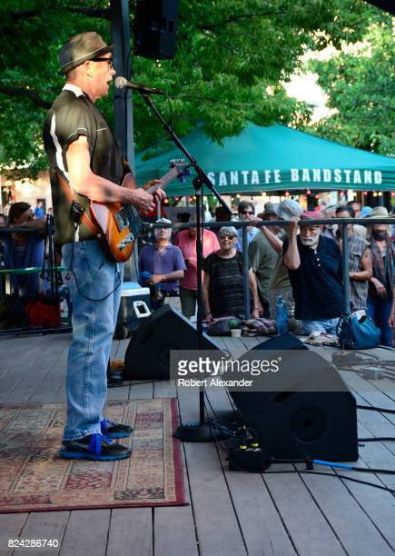 Billy Desmond lead singer for the blues/rock musical group Billy D and the Hoodoos performs with his Portland Oregon band in the historic Plaza in...