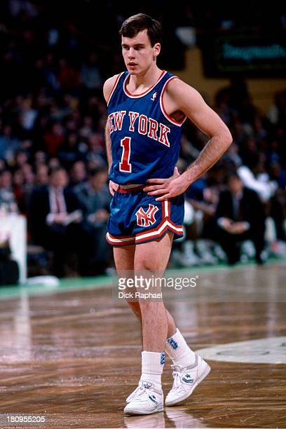Billy Donovan of the New York Knicks looks on against the Boston Celtics during a game circa 1988 at the Boston Garden in Boston Massachusetts NOTE...
