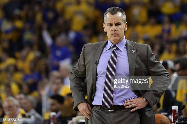 Billy Donovan of the Oklahoma City Thunder looks on during Game Five of the Western Conference Finals against the Golden State Warriors during the...