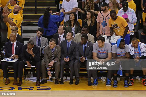 Billy Donovan of the Oklahoma City Thunder sits on the bench with his coaching staff in Game Five of the Western Conference Finals against the Golden...