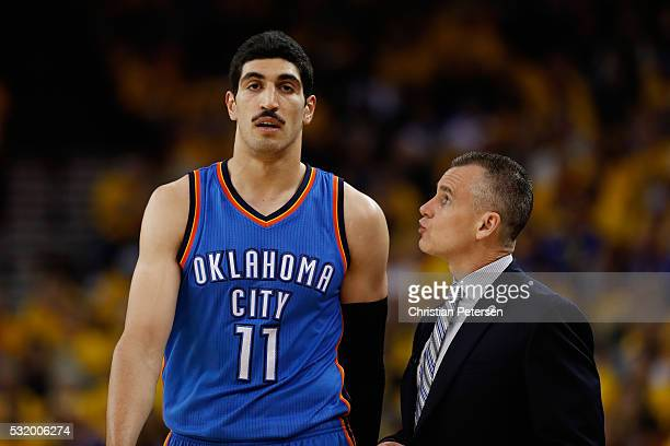 Billy Donovan of the Oklahoma City Thunder talks with Enes Kanter during game one of the NBA Western Conference Finals against the Golden State...