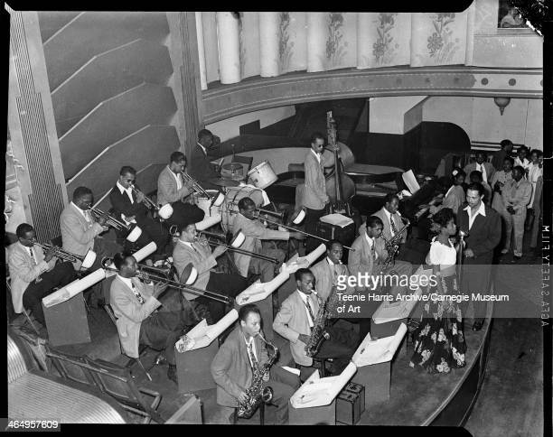 Billy Eckstine orchestra performing on stage seen from above including Sarah Vaughan and Billy Eckstine Lucky Thompson Charlie Parker Bob 'Junior'...