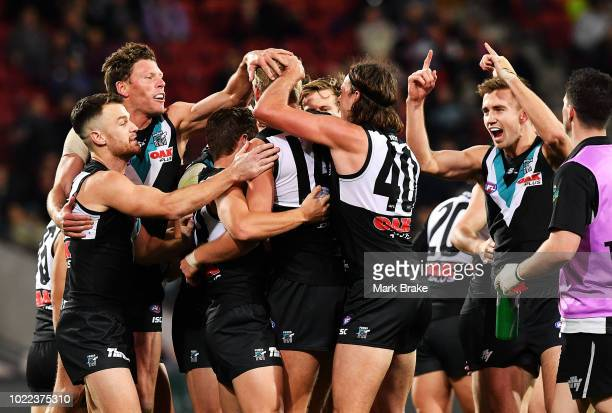 Billy Frampton of Port Adelaide celebrates his first goal during the round 23 AFL match between Port Adelaide Power and the Essendon Bombers at...