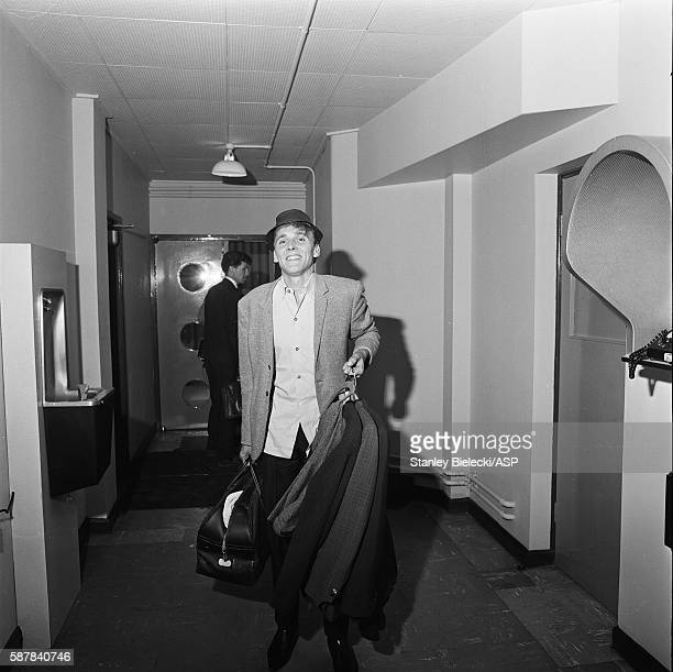 Billy Fury backstage carrying jackets and a sports bag United Kingdom circa 1965