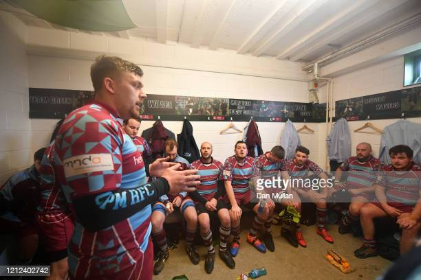 Billy Garratt of OPMs talks to his players in the changing room at half time during the Lockie Cup Semi Final match between Old Plymouthian and...