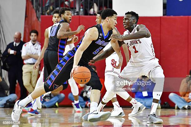 Billy Garrett Jr #5 of the DePaul Blue Demons is defended by Bashir Ahmed of the St John's Red Storm at Carnesecca Arena on January 16 2017 in New...