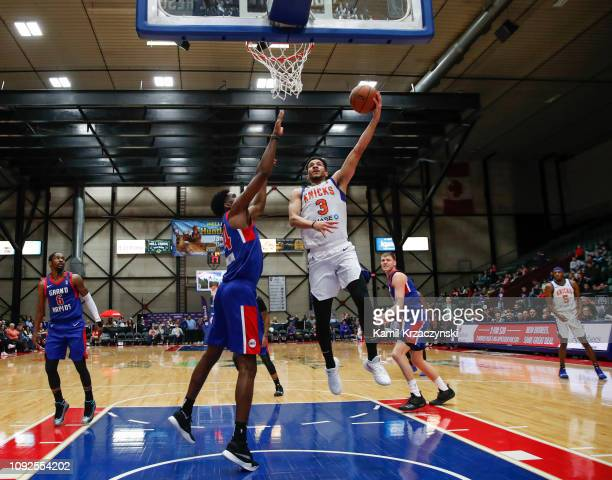 Billy Garrett of the Westchester Knicks goes to the basket against Johnny Hamilton of the Grand Rapids Drive during the first half of an NBA GLeague...