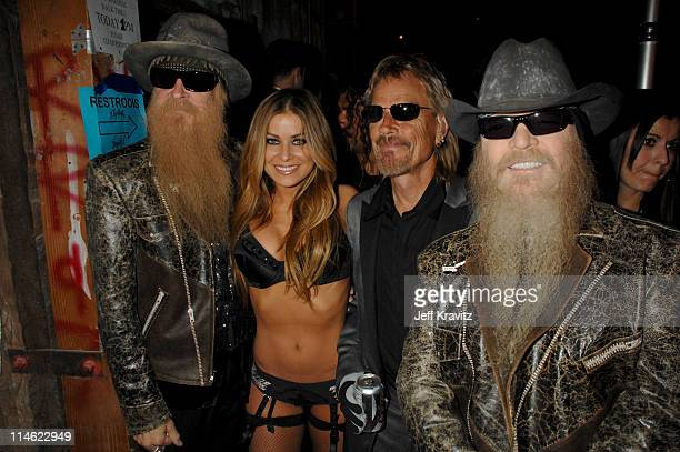 Billy Gibbons Frank Beard and Dusty Hill of ZZ Top with Carmen Electra