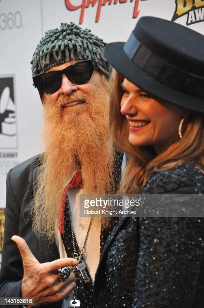 Billy Gibbons of ZZ Top with his wife Gilligan Stillwater at the 2012 Revolver Golden Gods Award Show at Club Nokia on April 11 2012 in Los Angeles...