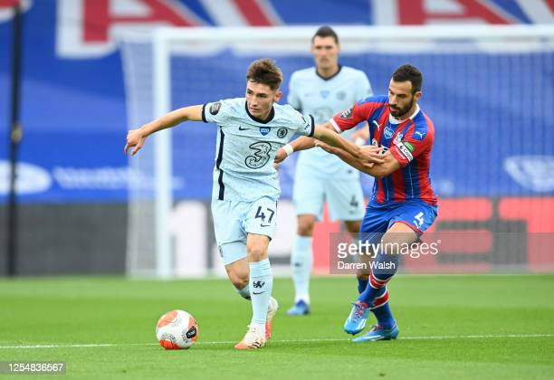 Billy Gilmour of Chelsea and Luka Milivojevic of Crystal Palace battle for the ball during the Premier League match between Crystal Palace and...