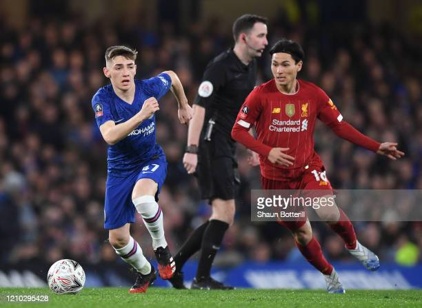 Billy Gilmour of Chelsea breaks away from Takumi Minamino of Liverpool during the FA Cup Fifth Round match between Chelsea FC and Liverpool FC at...