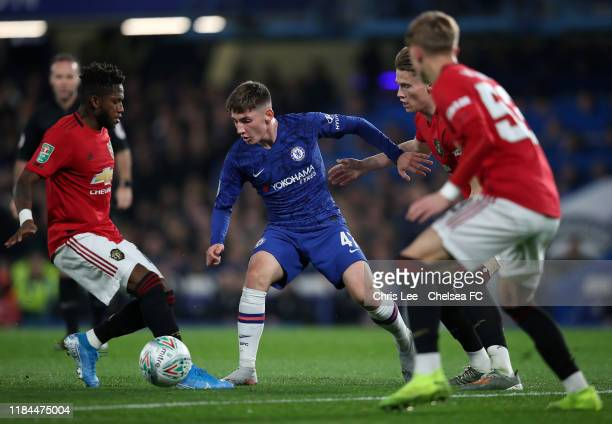 Billy Gilmour of Chelsea is challenged by Scott McTominay and Fred of Manchester United during the Carabao Cup Round of 16 match between Chelsea and...