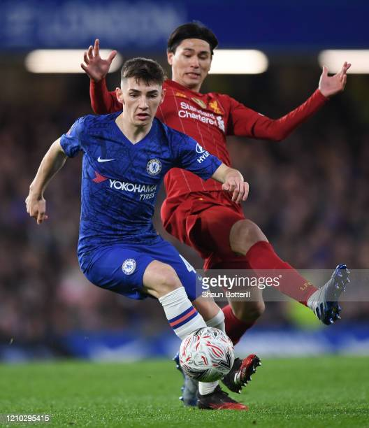Billy Gilmour of Chelsea is challenged by Takumi Minamino of Liverpool during the FA Cup Fifth Round match between Chelsea FC and Liverpool FC at...