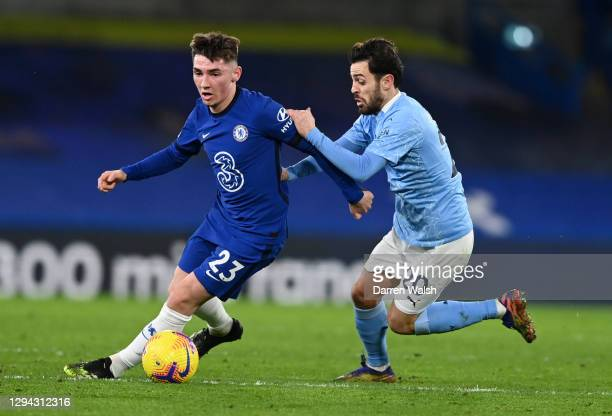 Billy Gilmour of Chelsea looks to break past Bernardo Silva of Manchester City during the Premier League match between Chelsea and Manchester City at...