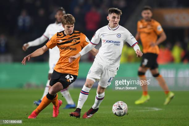 Billy Gilmour of Chelsea runs with the ball as he is put under pressure by Martin Samuelsen of Hull City during the FA Cup Fourth Round match between...