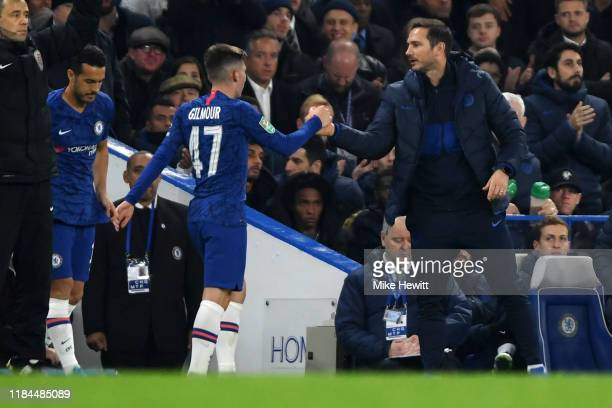 Billy Gilmour of Chelsea shakes hands with Frank Lampard Manager of Chelsea as he is substituted off during the Carabao Cup Round of 16 match between...