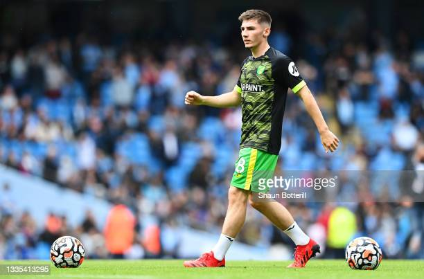 Billy Gilmour of Norwich City looks on as he warms up prior to the Premier League match between Manchester City and Norwich City at Etihad Stadium on...