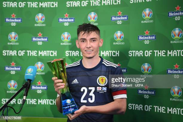 """Billy Gilmour of Scotland poses for a photograph with their Heineken """"Star of the Match"""" award after the UEFA Euro 2020 Championship Group D match..."""
