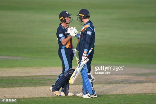 Billy Godleman congratulates Wayne Madsen of Derbyshire Falcons after he scores 50 runs during the NatWest T20 Blast match between Worcestershire...