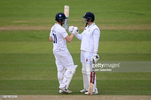 Billy Godleman of Derbyshire celebrates his 50 with Matt Critchley of Derbyshire during Day four of the LV= Insurance County Championship between...