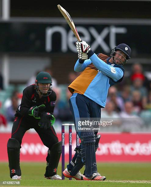 Billy Godleman of Derbyshire hits the ball towards the boundary as Niall O'Brien of Leicestershire looks on during the NatWest T20 Blast match...