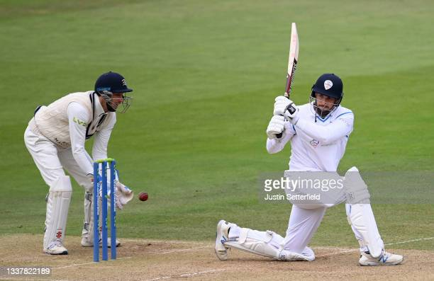 Billy Godleman of Derbyshire plays a shot as John Simpson of Middlesex looks on during Day four of the LV= Insurance County Championship between...
