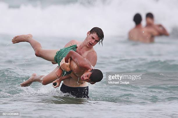Billy Gowers of the Blues picks up Tom Silvagni younger brother of Jack Silvagni during a recovery session a the beach during the Carlton Blues AFL...