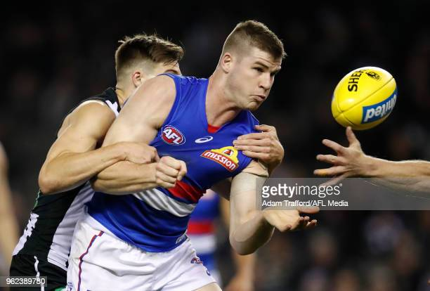 Billy Gowers of the Bulldogs is tackled by Josh Thomas of the Magpies during the 2018 AFL round 10 match between the Collingwood Magpies and the...
