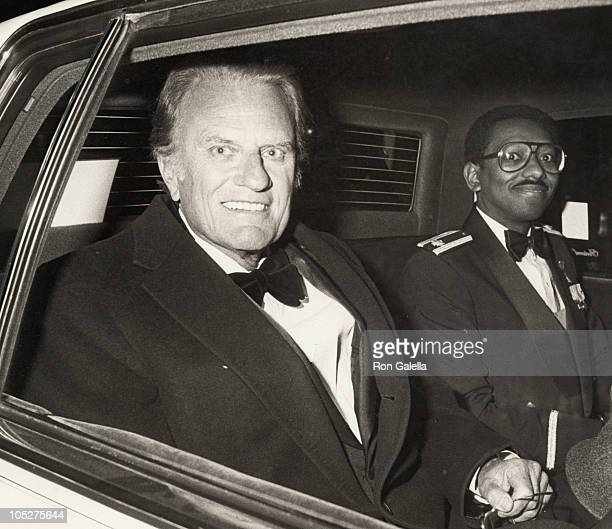 Billy Graham and escort during Gala Inaugural Tribute to President Reagan First Lady Nancy Reagan at The Madison Hotel in Washington DC United States