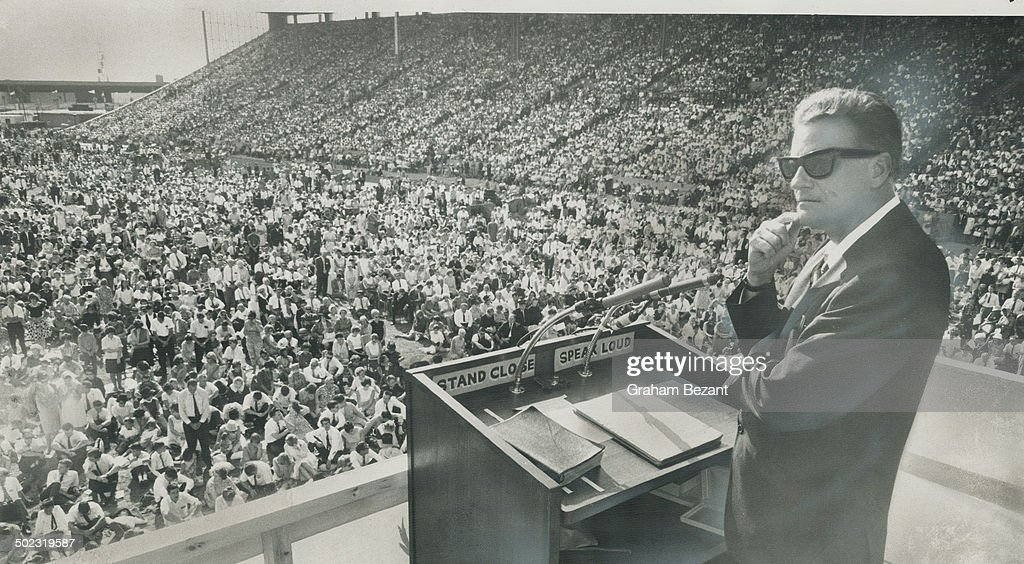 Billy Graham; left; leading a crusade in the CNE grandstand. His religious broadcasts are aired in C : News Photo