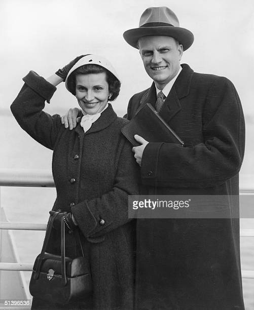 Billy Graham the American evangelist and his wife Ruth pose aboard the liner 'United States' 23 February 1954 before their arrival from New York to...