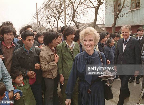 Billy Graham the American evangelist and his wife Ruth smile 19 April 1988 as they meet Chinese inhabitants of Ruth birthplace in Huaiyin Jiangsu...