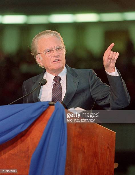 Billy Graham the American evangelist preaches 23 October 1992 in front of an estimated crowd of 30000 faithful gathered in Moscow's Olympic Stadium...