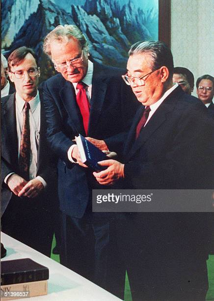 Billy Graham the American evangelist presents his book 'Peace with God' to North Korean President Kim ilSung 02 April 1992 in Pyongyang Graham...