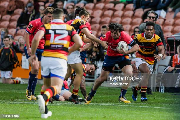 Billy Guyton from Tasman stiff arming a tackler during the round three Mitre 10 Cup match between Waikato and Tasman on September 3 2017 in Hamilton...