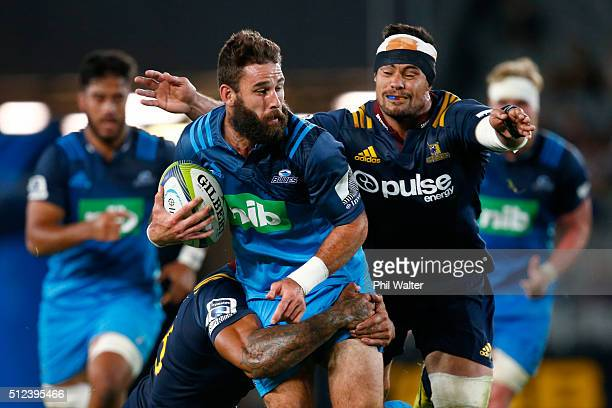 Billy Guyton of the Blues is tackled during the round one Super Rugby match between the Blues and the Highlanders at Eden Park on February 26 2016 in...