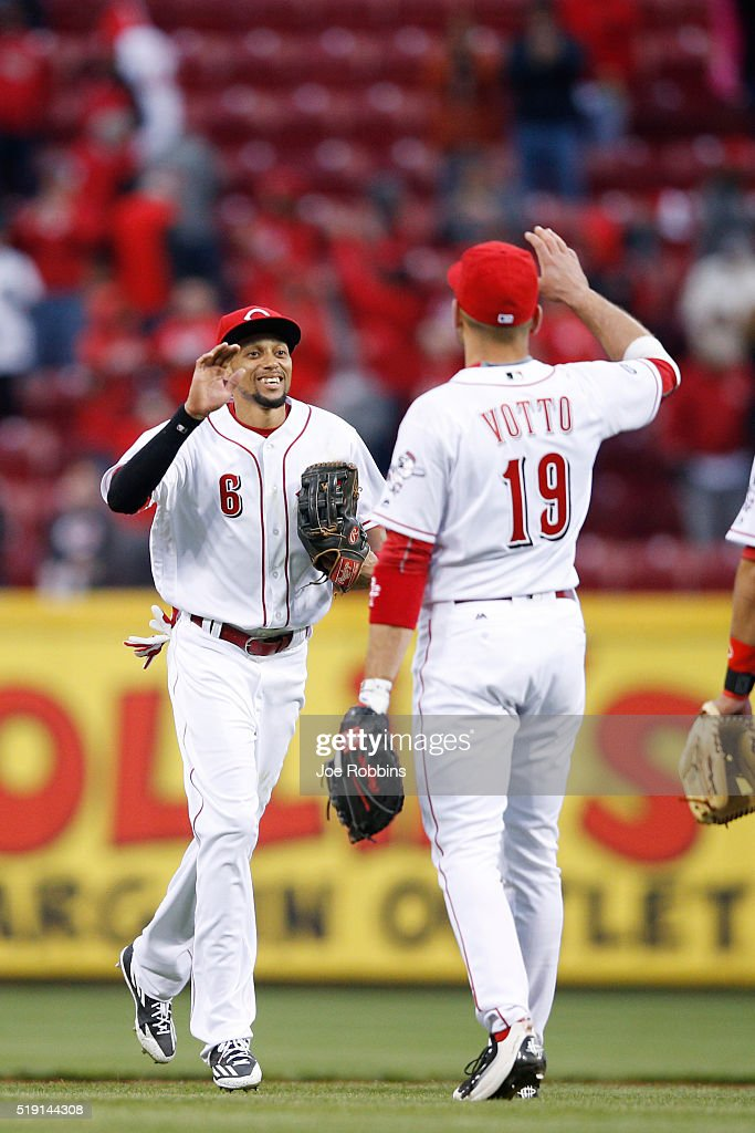 Billy Hamilton #6 and Joey Votto #19 of the Cincinnati Reds celebrate after the final out of the opening day game against the Philadelphia Phillies at Great American Ball Park on April 4, 2016 in Cincinnati, Ohio. The Reds defeated the Phillies 6-2.