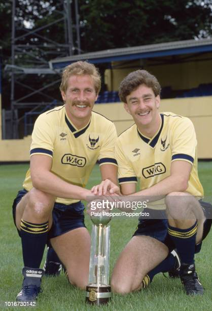 Billy Hamilton and John Aldridge of Oxford United with the Canon League Division Two trophy at the Manor Ground on July 29 1985 in Oxford England
