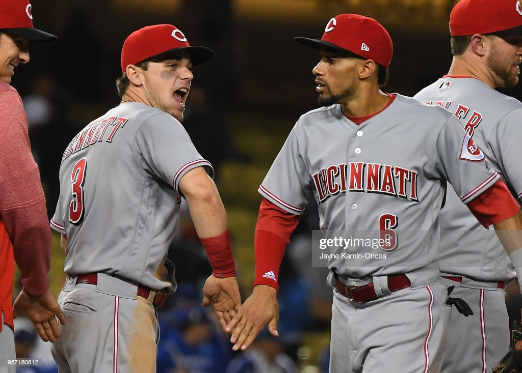 Billy Hamilton #6 is greeted by Scooter Gennett #3 of the Cincinnati Reds after defeating the Los Angeles Dodgers in the ninth inning at Dodger Stadium on May 10, 2018 in Los Angeles, California.